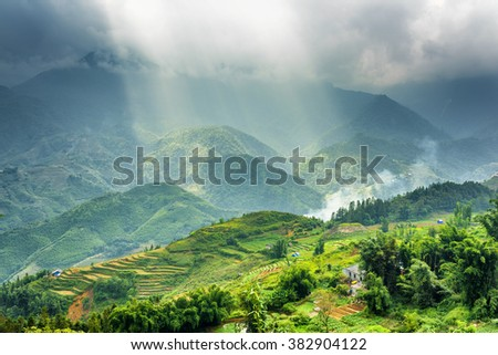 Amazing view of rays of sunlight through storm clouds in the Hoang Lien Mountains of Sapa District, Lao Cai Province, Vietnam. Sa Pa is a popular tourist destination of Asia.