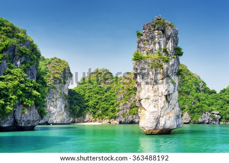 Amazing view of rock pillar and azure water in the Ha Long Bay (Descending Dragon Bay) at the Gulf of Tonkin of the South China Sea, Vietnam. The Halong Bay is a popular tourist destination of Asia. - stock photo