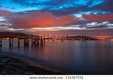 amazing view of sunset with old harbor - stock photo