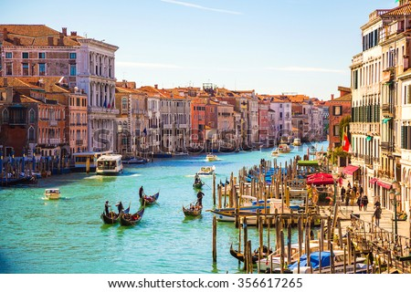 stock photo amazing view on the beautiful venice italy many gondolas sailing down one of the canals 356617265 - Каталог — Фотообои «Венеция»