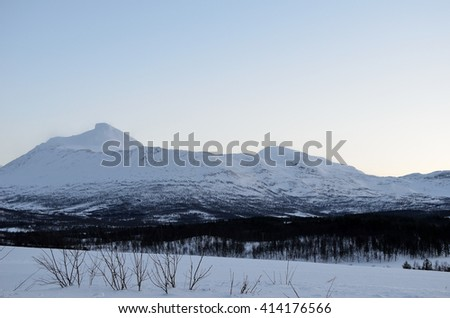 Amazing white snow covered mountain range in Norway in winter