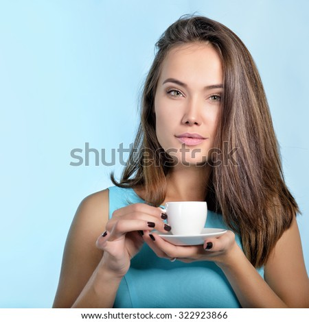 Amazing woman holding cup of coffee. Perfect female beauty.  - stock photo