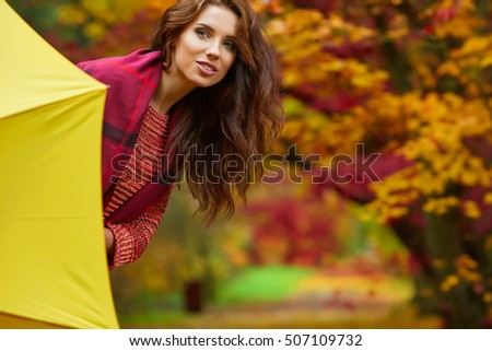 Amazing woman in autumn park