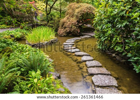 Amazingly beautiful decorative private garden in western Canada Butchart Gardens. The track of the stones in the Japanese part of the garden - stock photo