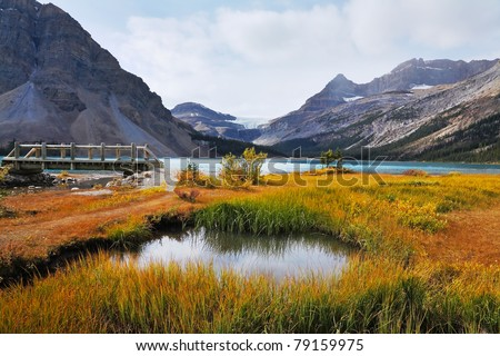 Amazingly beautiful lake in the Rocky Mountains of Canada. Wooden bridge and azure water - stock photo