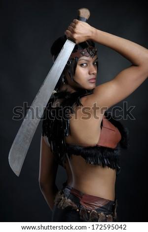 Amazon girl with the machete - stock photo