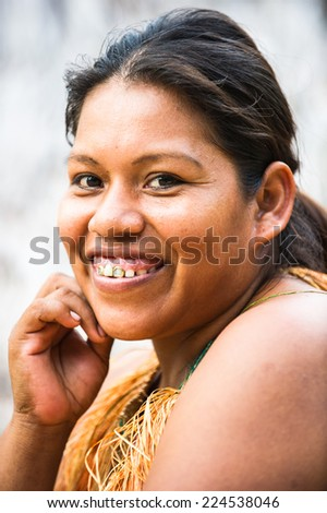 AMAZONIA, PERU - NOV 10, 2010: Unidentified Amazonian indigenous smiling woman. Indigenous people of Amazonia are protected by COICA (Coordinator of Indigenous Organizations of the Amazon River Basin) - stock photo