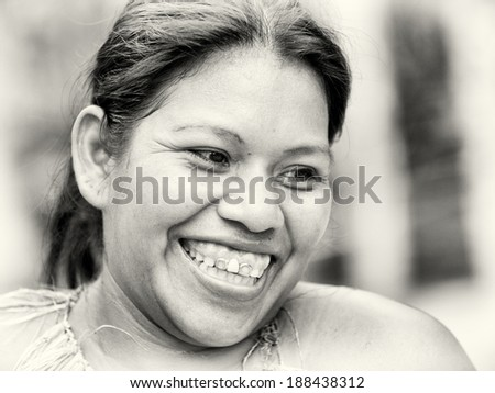 AMAZONIA, PERU - NOV 10, 2010: Unidentified Amazonian smiling beautiful girl. Indigenous people of Amazonia are protected by  COICA (Coordinator of Indigenous Organizations of the Amazon River Basin)
