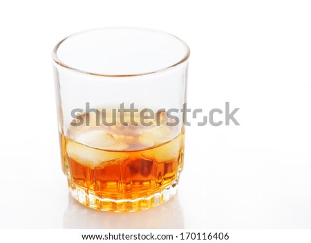 Amber alcohol, drink in a glass with ice on white  - stock photo