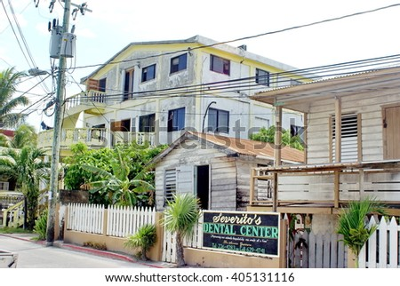 AMBERGRIS KEY, BELIZE - CIRCA MAY 2014: Wooden buildings for houses and businesses on a main road