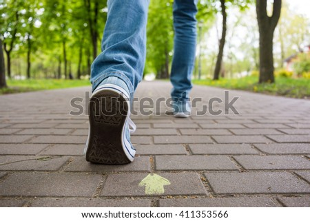 Ambitions concept: young man going towards success - stock photo