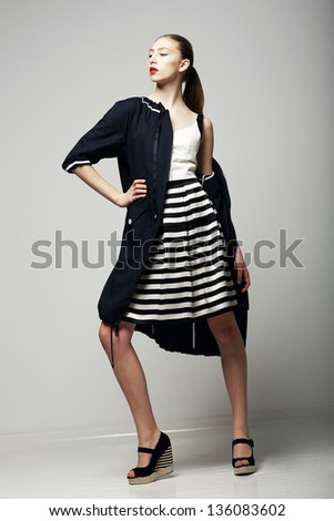 Ambitions. Confident Honorable Brunette in Black Waterproof Mackintosh. Vogue Style - stock photo