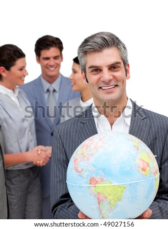 Ambitious manager and his team holding a terrestrial globe against a white background