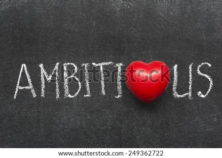 ambitious word handwritten on blackboard with heart symbol instead of O
