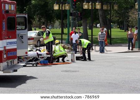 Ambulance at motorcycle crash - stock photo