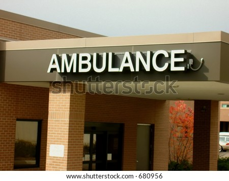 Ambulance in white letters on building.