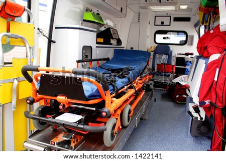 Ambulance interior details. Emergency equipment and devices visible