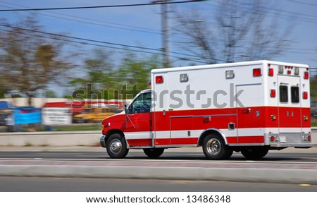 Ambulance speeding on an American street heading to an emergency