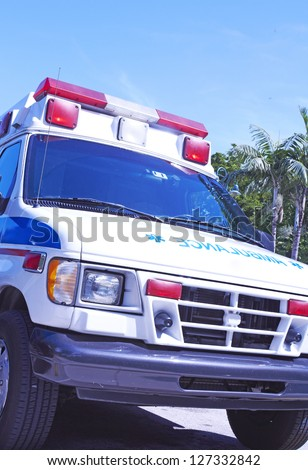 Ambulance to the rescue - stock photo
