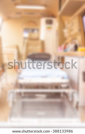 ambulance use for emergency patient which is blur for background - stock photo