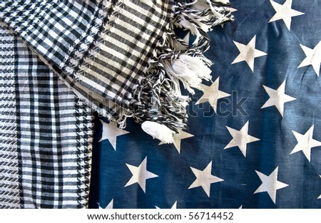 America and the Middle East. Symbol. Arab yashmak against the background of a fragment of an American flag.