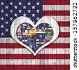 America flag,Flags of the U.S. states, background wood in the shape of heart - stock