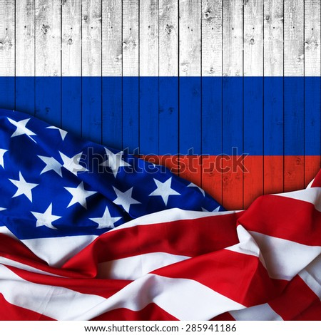 America flag of fabric  and Russia flag of wood - stock photo