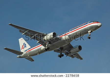American Airlines plane on final approach with blue sky