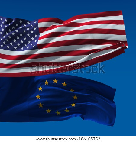 American and European Union flags waving upon blue sky