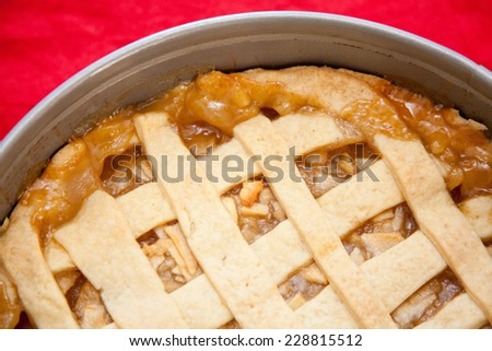 American Apple Pie, on a table on a red table cloth.