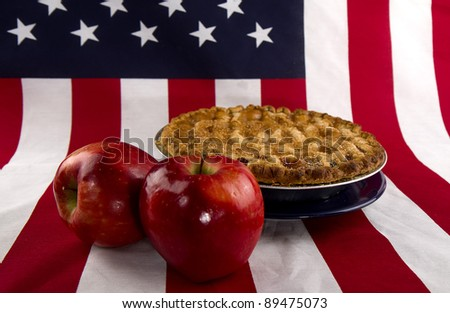 American as Apple Pie Concept - Flag and apples/pie