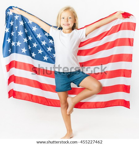 American blonde girl holding American national flag. Doing gymnastics element. USA. Patriot. School child. Back to school. Fan. White background - stock photo