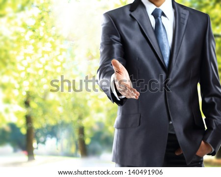american businessman handshake gesture - stock photo