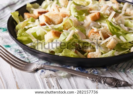 American Classic Caesar Salad close-up on a plate on the table. Horizontal  - stock photo