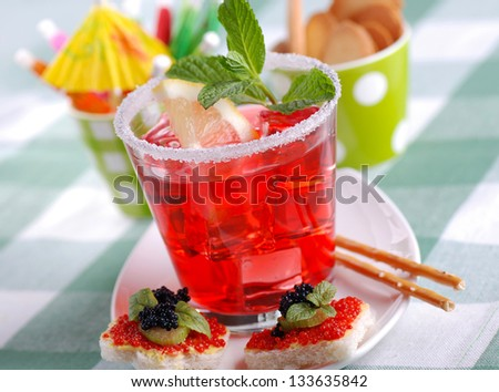 American cocktail with ice and mint leaf