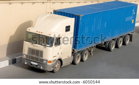 American container truck on road. See many similar quality images in my portfolio - stock photo