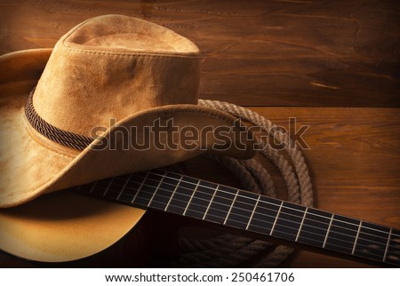American Country music background with guitar and cowboy hat - stock photo