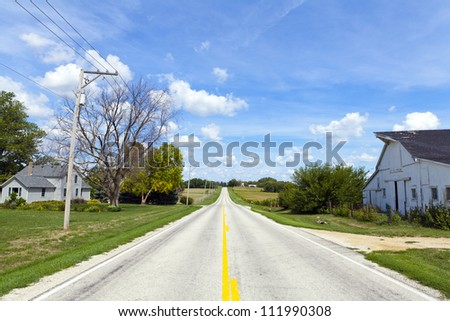 American Countryside Road With Farm Buildings