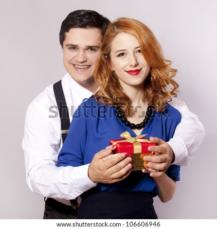 American couple with girt. Photo in 60s style. - stock photo