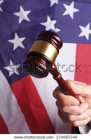 american court, gavel in front of an american flag - stock photo
