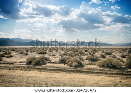 American Desert with mountains in the background - stock photo