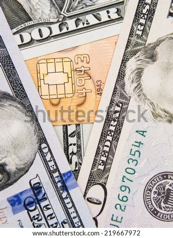 American dollar bills and a credit card concepts of finance  - stock photo