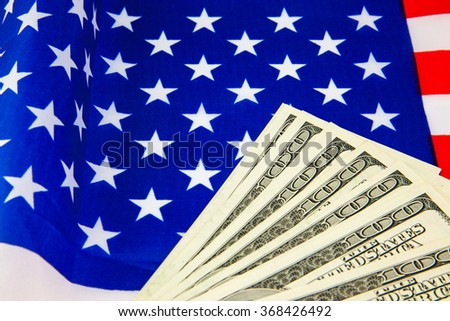 American dollars and flag. Stock images. Top.