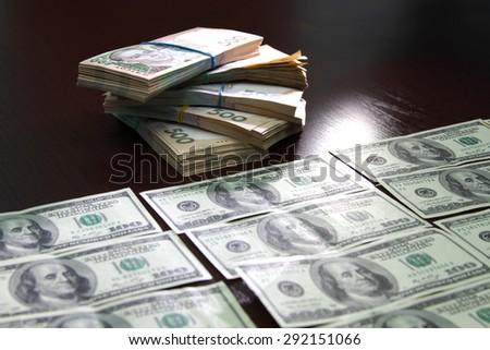 American dollars and Ukrainian hryvnia - stock photo
