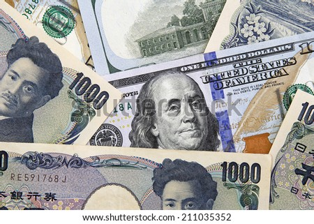 american dollars and yens- concept of currency exchange rate  - stock photo