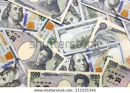 american dollars and yens- concept of exchange rate  - stock photo