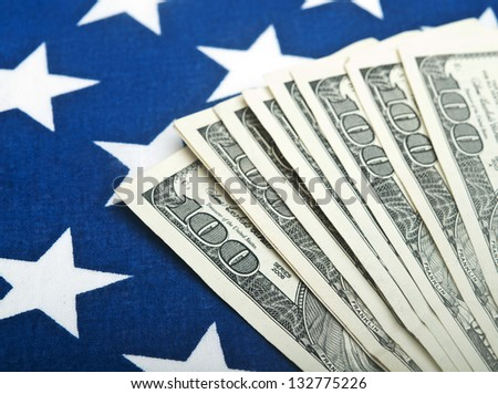 american dollars bills on flag background