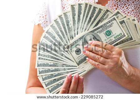 American dollars in a women hands. - stock photo
