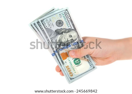 American dollars in hand isolated on white background - stock photo