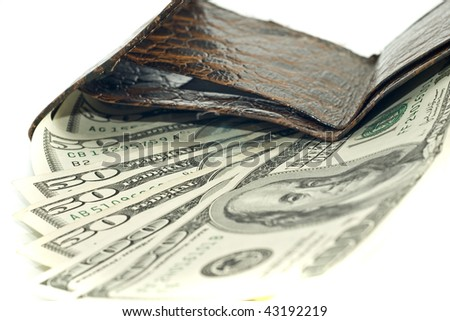 American dollars in opened obsolete wallet (shallow DOF) - stock photo